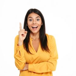 Picture of amazing happy young lady in yellow shirt standing isolated over white background have an idea.